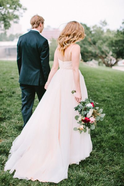 A pink dress, gorgeous blooms, and a happy couple: http://www.stylemepretty.com/2014/11/26/glamorous-diy-wedding-at-the-dayton-ohio-art-institute/ | Photography: Jenny Haas - http://www.jennyhaas.com/