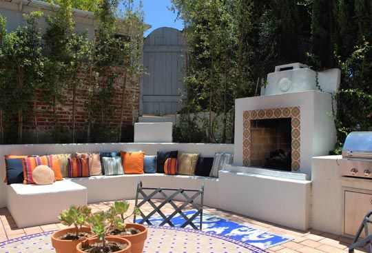 Rooftop terrace with inbuilt seating and fireplace
