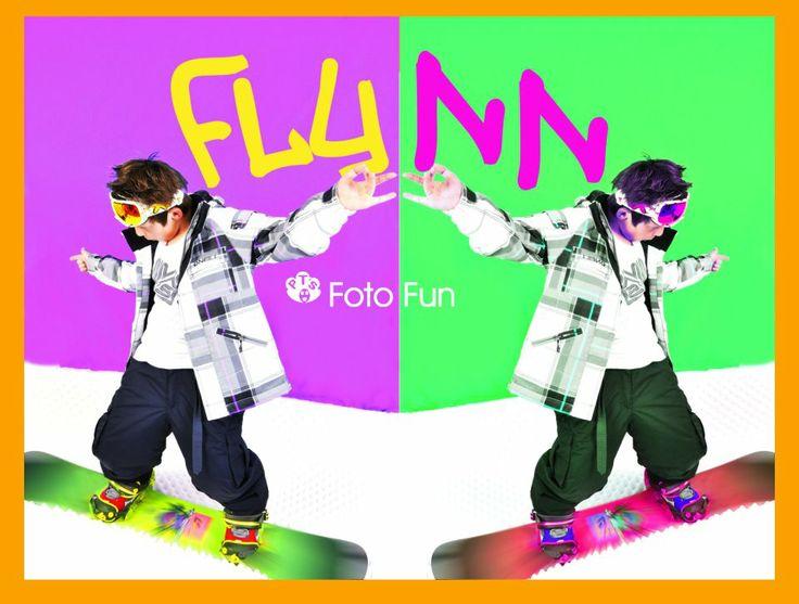 Cool boy in snow boarding set