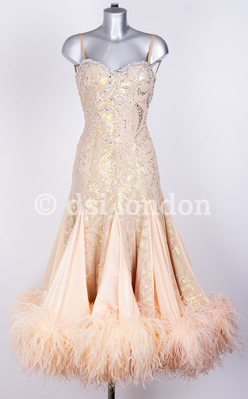 Champagne ballroom gown with feather bottom