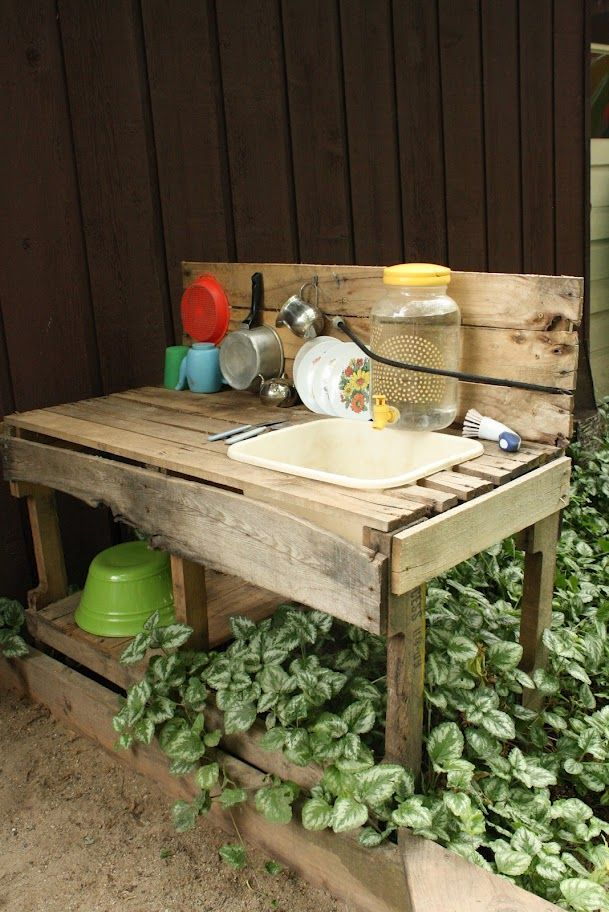 Mud kitchen with clever water-saving water dispenser over sink ~ an outside sink connected to a part of the garden