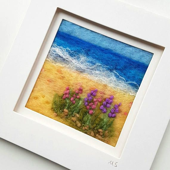 An original piece of textile art by Shropshire-based artist Maxine Smith. A one of a kind needle felted and hand embroidered picture inspired by the natural environment.  This felted coastal scene has been created by hand using wet felting, needle felting and hand embroidery to create a typical British seaside landscape.  The felted seascape is presented in a free standing white frame with mount.  The approximate measurements are: Artwork: 3.5x3.5 inches / 9x9cm Frame: 7x7 inches / ...