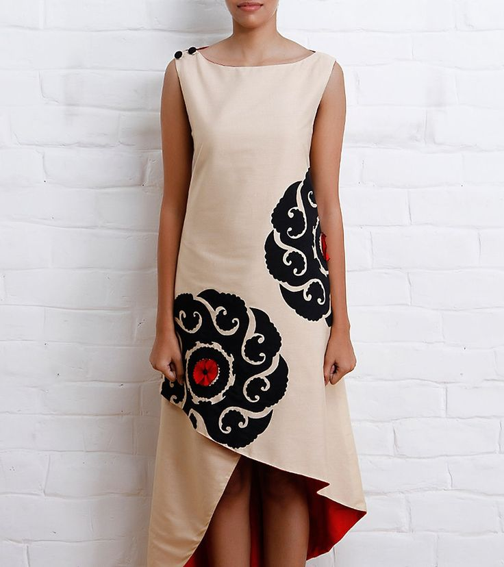 This is a beige katan silk dress with fiery red cotton silk lining.<br/><br/>It features chakra applique on the front and back.<br/><br/>The dress has a boat neckline and buttons embellished on one shoulder.<u><br/><br/><br/>This product by Poonam Bhagat