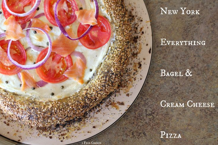 New York Everything Bagel and Cream Cheese Pizza with Lox  A  pizza with all of the components of a New York bagel: Everything bagel crust, with smooth garlic & parmesan white cream cheese sauce. http://www.1finecookie.com/2014/01/new-york-everything-bagel-pizza-with-cream-cheese-sauce-and-lox/ salmon, salty, cured, smoked, crust, new york, nyc, bagel, dough, everything, pizza, white sauce, homemade, recipe, lox, tomatoes, poppy seed, bagels, new york, fresh, baked, gourmet, cheese, dinner,