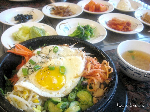 Another one of my favorite Korean Dishes: Dol Sot Bibimbap (pronounced Bee Bim Bop). Pictured here as it is traditionally served. With various kimchees/sides and radish soup. This is also served with Korean hot bean paste (Ko Choo Jong) which is mixed in with the egg, vegetables and rice in a sizzling stone bowl (this is the Dol Sot part).