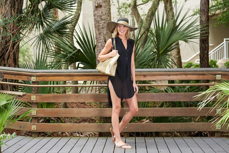 Striped floppy hat and gold beach bag by Pia Rossini