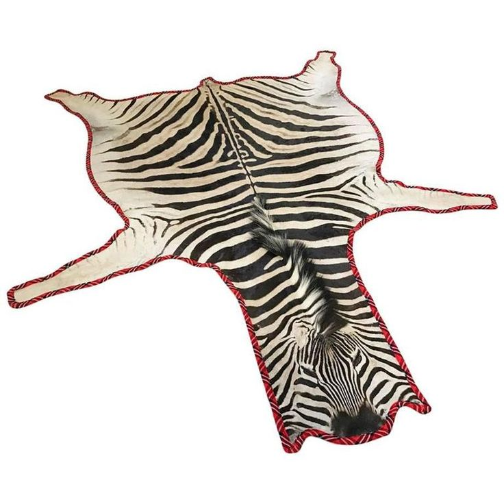 Zebra Hide Rug Trimmed in Maasai Warrior Blanket | From a unique collection of antique and modern more carpets at https://www.1stdibs.com/furniture/rugs-carpets/area-rugs-carpets/