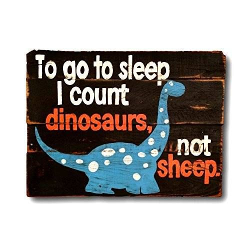 """Wood wall hanging, hand painted on reclaimed wood. Perfect for a baby shower gift and makes an adorable addition to any nursery decor. Sign pictured is 18""""x 24"""" in size and has a black background with white & orange lettering and a bright blue dinosaur."""