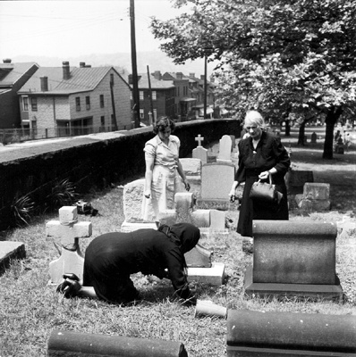 CAPTION: St. Mary's Cemetery, Memorial Day.  Pittsburgh, PA.   NOTES:   PHOTOGRAPHER: Esther Bubley.   DATE: July 1950.  HEADING:   #: [165].  From the Collections of the Pennsylvania Department,  The Carnegie Library of Pittsburgh.