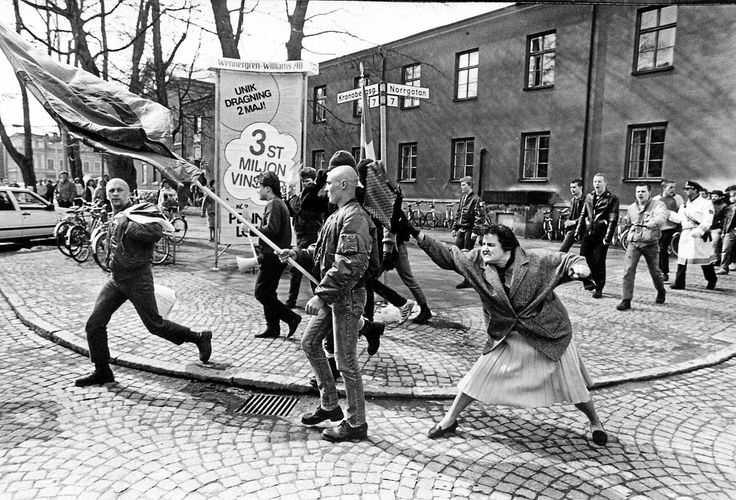 """""""this is a photograph of the lovely incident, appropriately titled A Woman Hitting a Neo-Nazi With Her Handbag"""""""
