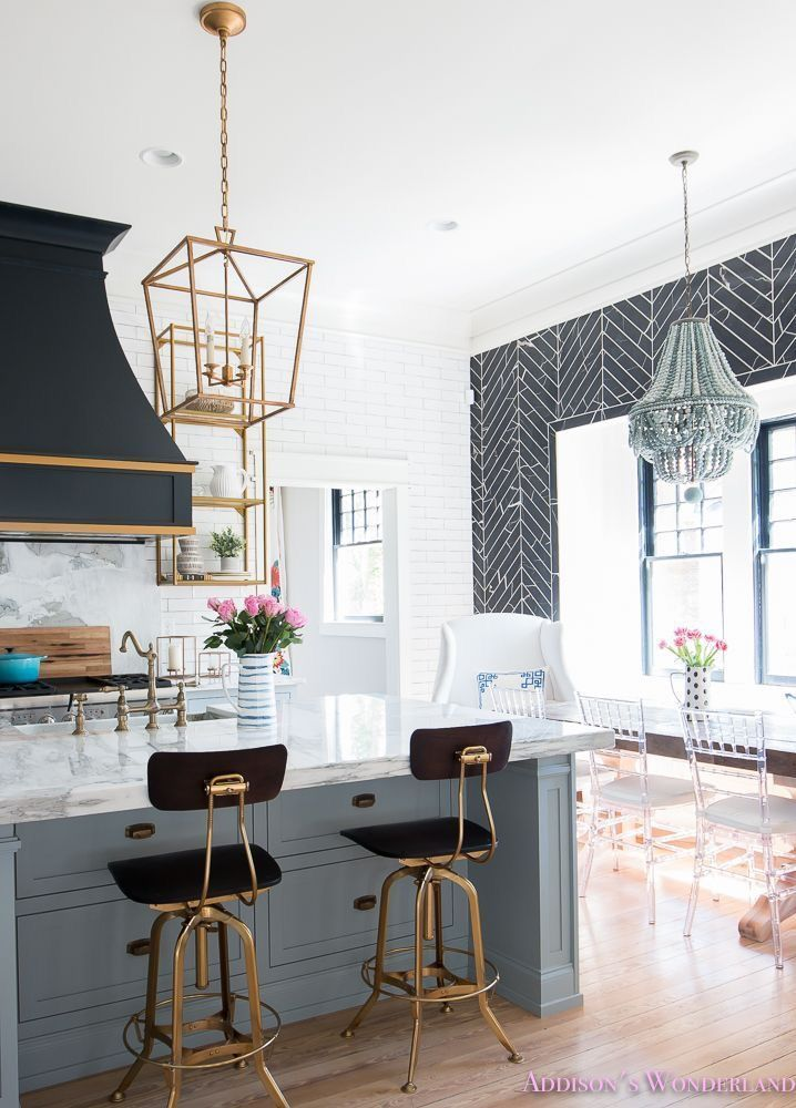 Love the black and brass stools in this modern kitchen