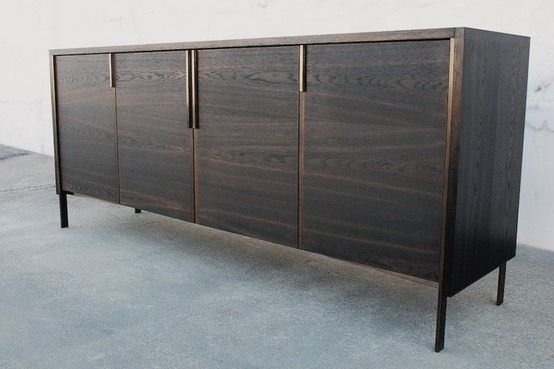Fumed Oak and brass credenza with bi-fold doors.