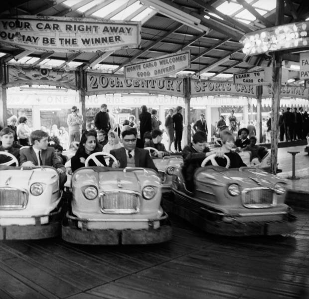 Couples on the dodgems ride, Battersea Park fun fair. 1966