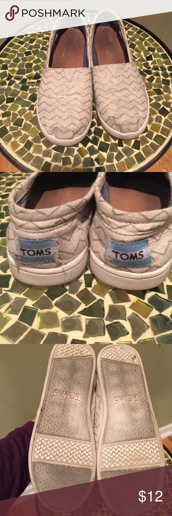 TOMS FLATS Used Girls Toms. Cute gold and ivory chevron style. The Tom's tag on the back of the shoe is coming apart. TOMS Shoes Moccasins