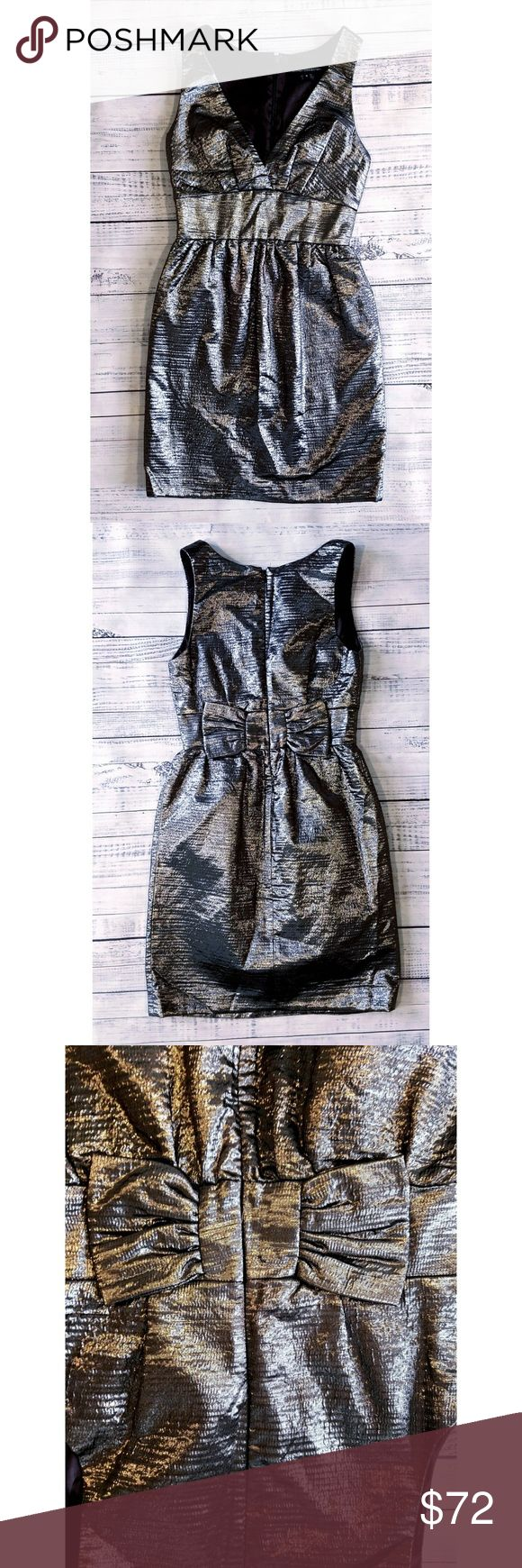 French Connection silver metallic party dress Worn once and dry cleaned  13 inch waist while flat  15.75 inches from armpit to armpit  33 inches long Metallic fabric Linned Zipper in back Virgin wool, polyester and polyamide/nylon French Connection Dresses