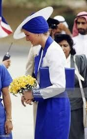 Princess Diana, Princess of Wales, wears a Philip Somerville turban hat during her visit to Dubai in March 1989.
