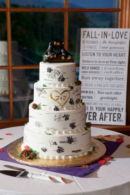 """A perfect example of a rustic themed wedding cake! Adorned with the newlyweds """"carved initials"""" into the frosting and the black bears as wedding toppers"""