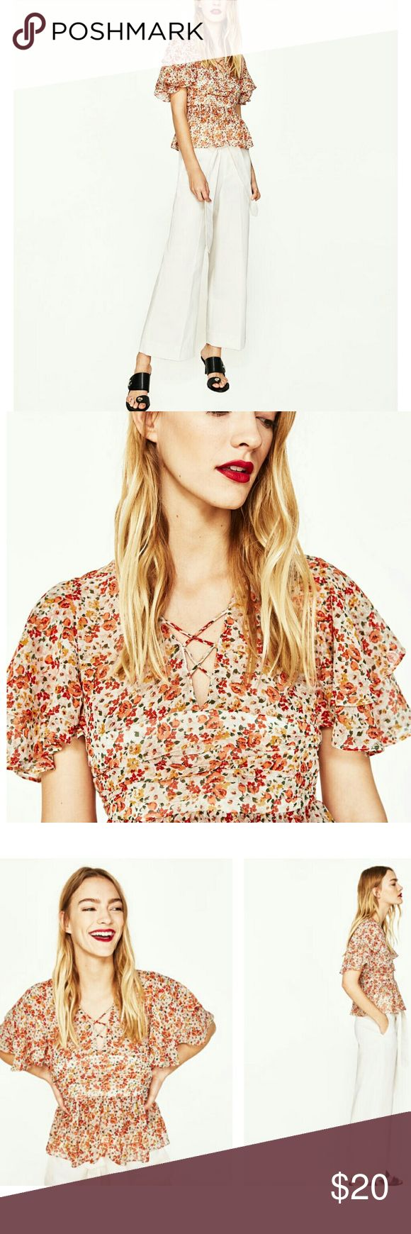 Floral Zara top This floral zara top with ruffle shoulder style is in trend. It's very beautiful and stylish. Brand new with tag. Currently sold out and out of stock. Zara Tops
