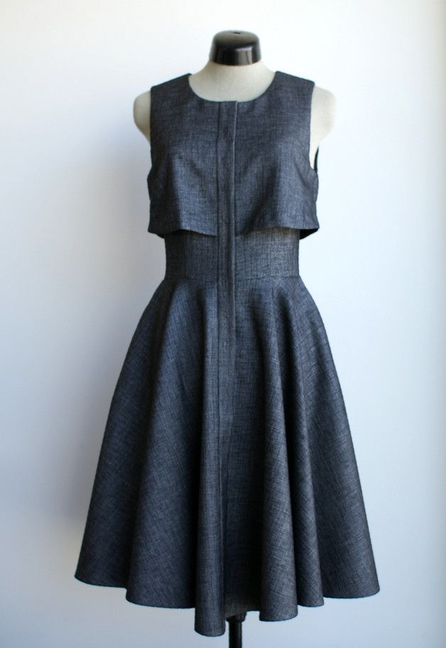 Little dark grey dress, sleeveless. Pleated back detail. Circle skirt. Bare back.Dress has pockets.  Attached by small snapfasteners. Without lining. Made of nicely falling dark grey fabric. Size...