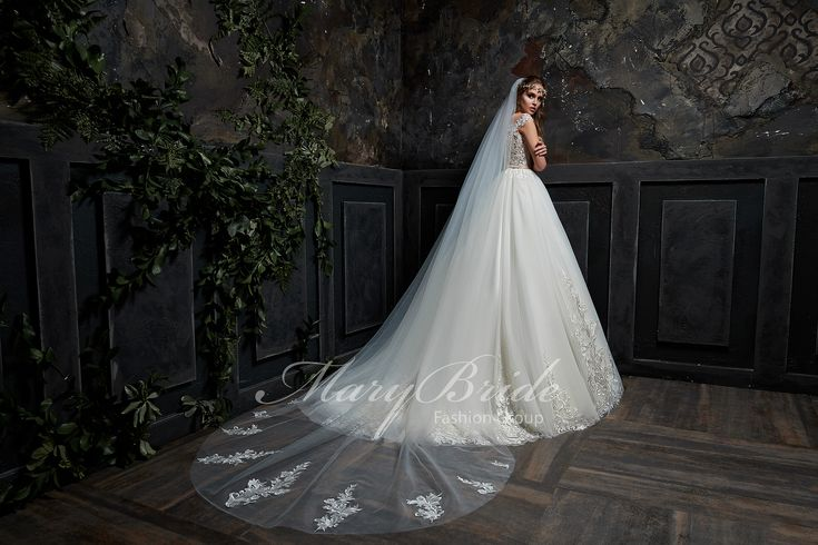 $2,999.99 Semi- transparent Corset Ball Gown Comes in  White, Ivory or As Shown in Photo (Blush) Come with Veil Corset Ball gown laces up then buttons up over Lace on portions of semitransparent fabric lace floral pattern  Longer train  Sweetheart neckline Veil matches dress details with lace on ends of veil comes with honeymoon