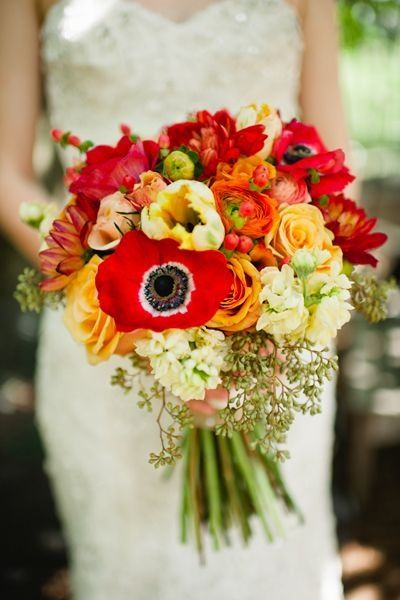 Cara likes this color scheme for bridal- whites, oranges, reds, greens, and sunflowers- medium in size and loosely structured
