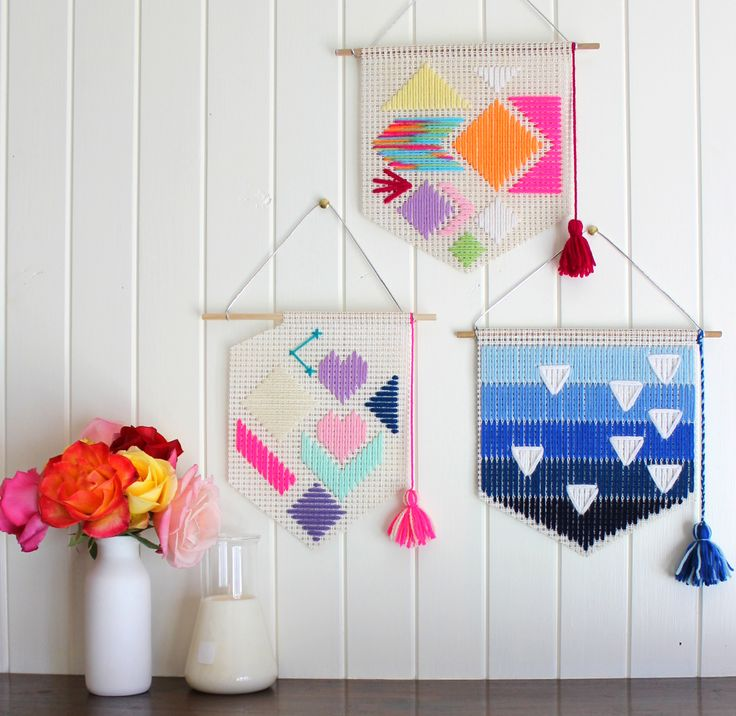 A colourful selection of geometric hand woven wall hangings by Fizzy Lime