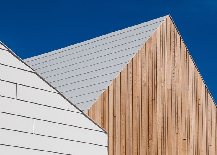 effekt / livsrum - 7 house-shaped buildings:  gabled roofs / vertical timber boards + white fibre-cement boards