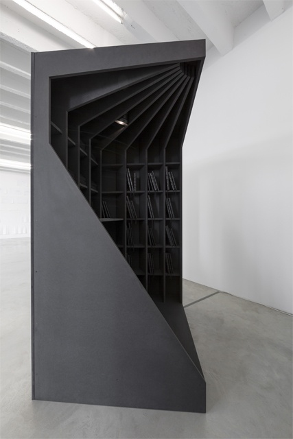 Iñaki Bonillas Braz Cubas, 2012, Cabinet (215 x 120 x 120 cm): black MDF & reading lamp, 41 books (dimensions variable), 17 postcards in an unlimited edition (15.3 x 10.8 cm each), sound piece composed in collaboration with Jacobo Lieberman (duration: 10min 13sec, looped), cabinet in collaboration with PRODUCTORA.