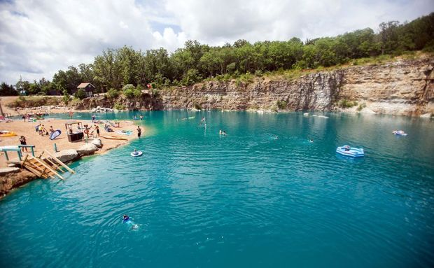 Trip down I-44 in Missouri : News The Fugitive Beach in Rolla is an old quarry that has been turned into a tourist attraction. You can zoom down a 60-foot slide or jump off 15 or 20 foot cliffs. Or just take a swim, float or play volleyball on the sand beach.