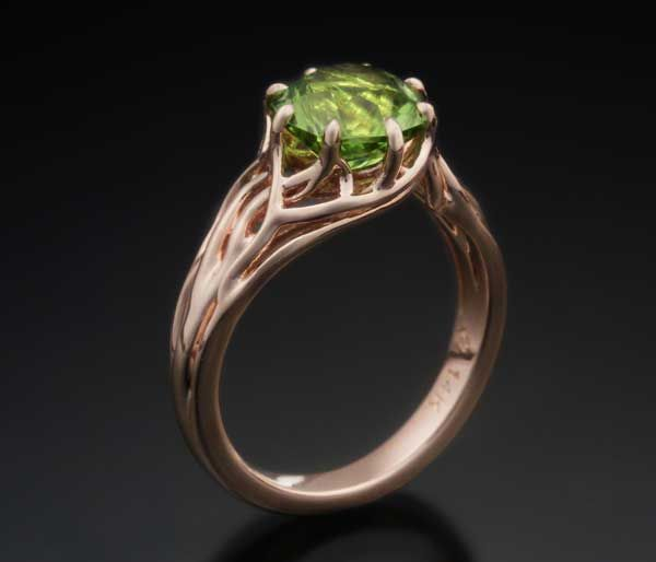 Our Embracing Tree Branch Engagement Ring in rose gold with a peridot center stone.