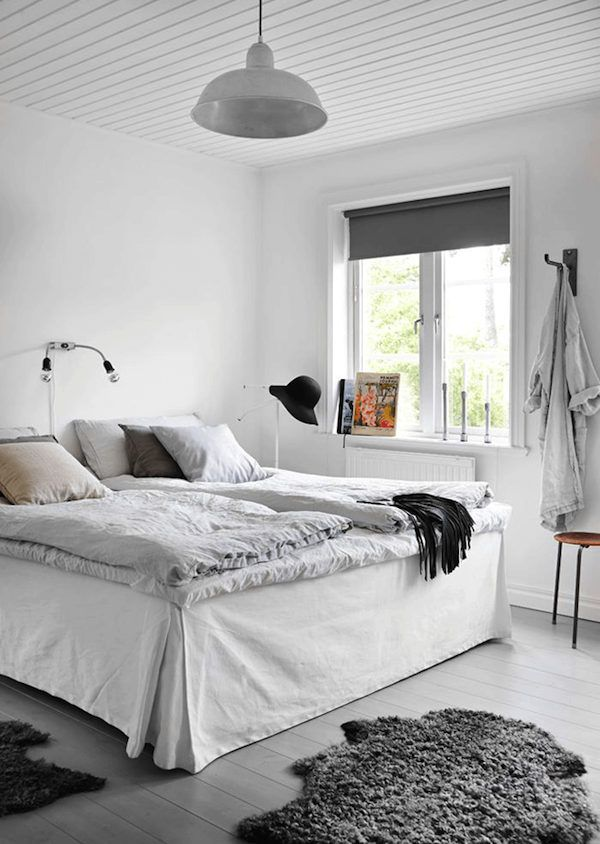 Shades of grey and white in the bedroom of an industrial inspired Swedish home.  Jonas Gustavsson / Charlotte Frey Sviden.