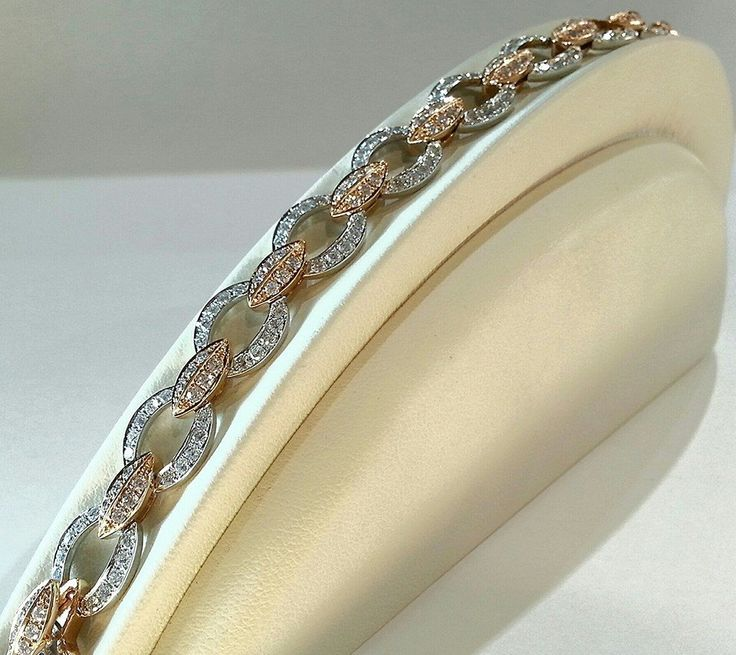 This beautiful 14K Rose and White Gold Diamond bracelet speaks for itself...And it's currently in our 50% off case!