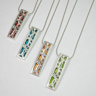 Fine Craft Silver & Delrin pendants by Meghan Wagg -Edmonton AB. Member of the Alberta Craft Council.