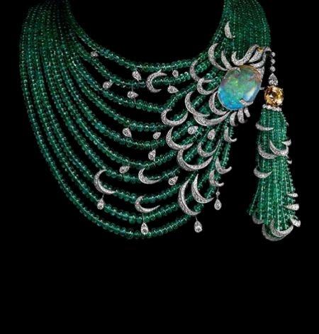 Van Cleef & Arpels.  Diamond, emerald, citrine, and opal.  Wow.