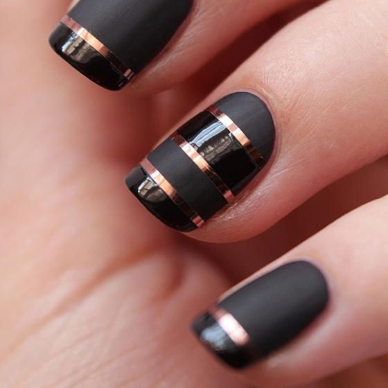 This nail look blends both matte and gloss black polishes with bands of shiny chrome in a copper finish. Metallic nail tape helps makes the lines perfectly crisp and hides any waviness between the black bands.