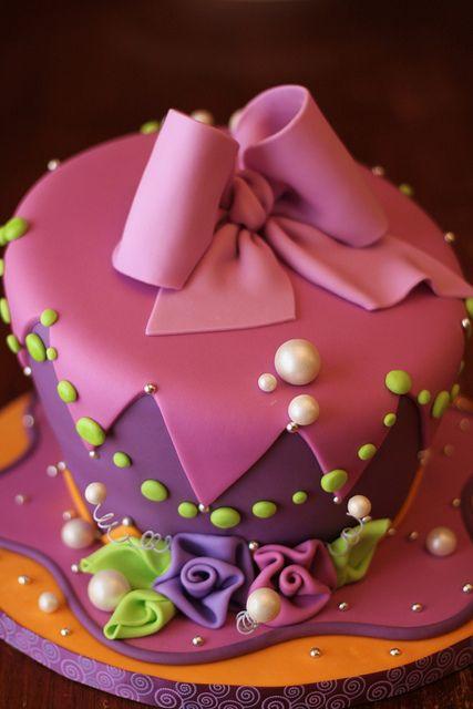 Pretty pink & purple fondant cake.