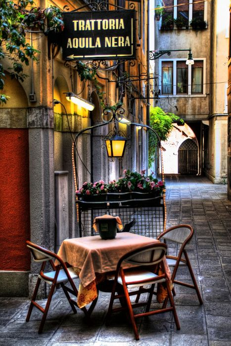 Sidewalk Cafe, Venice, Italy  Yes, you can find quiet, picturesque little spots in Venice not overrun by tourist hordes. Not easy, especially in summer, but you can do it. Close to the Hotel Bartolomeo, not far from the Rialto bridge.  https://www.google.co.za/maps/place/Hotel+Bartolomeo/@45.437991,12.337508,16z/data=!4m2!3m1!1s0x0:0x6ea32c69768f2e53