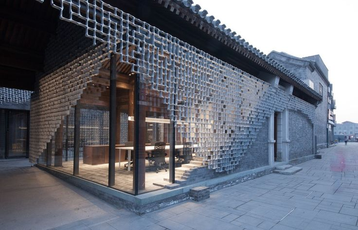 The design team modernized a traditional Chinese courtyard home into a new café and office space.