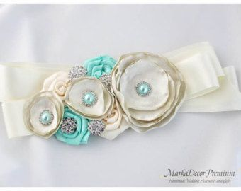 Bridal Custom Sash / Wedding Bridesmaids Belt in Ivory, Tan, Champagne and Aqua (Mint) with Brooches, Beads, Pearls, Crystals, Jewels and Handmade Flowers Collection Elegance    The sash has been crafted with quality handmade flowers, sparkly brooches, my stamens accents, bunch of glass Czech pearls and rhinestones. Each Markadecors accessory is unique and one-of-a-kind custom made masterpiece. Each flower has been designed by me and created by my hands from scratch. Many fabrics, lace and…