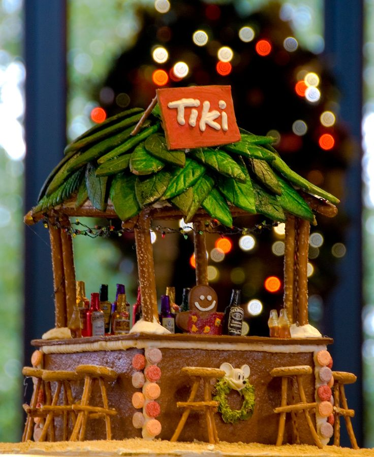 OMG - I have to make one of thse for the Parrothead Party!!!! Polynesian gingerbread house