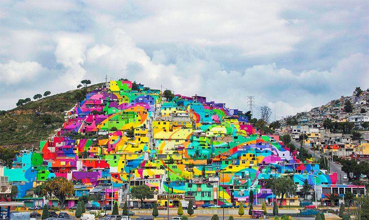 Um bairro de baixa renda no México é agora o assunto da cidade. germen tripulação - uma organização juvenil de muralistas e artistas de rua - transformaram a vila de palmitas em um arco-íris vibrante, ligando a comunidade de mais de 200 casas através de uma série de tons coloridos.
