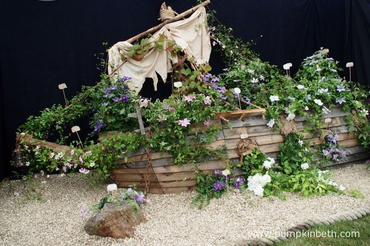 A shipwrecked boat covered in clematis from Floyd's Climbers and Clematis in the Floral Marquee.