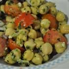 Chickpea Salad with Red Onion and Tomato -  Chilling makes all the difference in this great salad. And the generous splash of olive oil and lemon juice brings out all the great veggie flavors. The chick peas add variety and a nice texture.