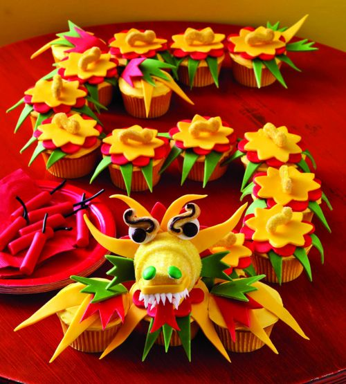 What a fantastically fun, creative, vibrantly hued Chinese Dragon Cupcake Display. #food #Chinese #dragon #New_Years #Asian #cupcakes #cake