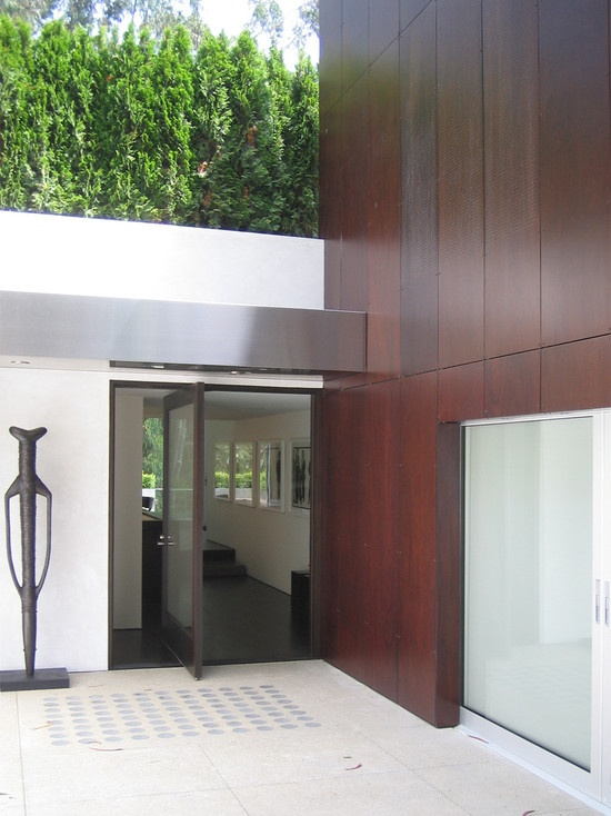 Exterior Wood Panel cladding and aluminium/stainless steel.