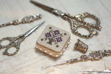 These are lovely.  The pin cushion is a pattern to be found at this site:  http://www.casamiainitalia.com/hp/csfc.htm