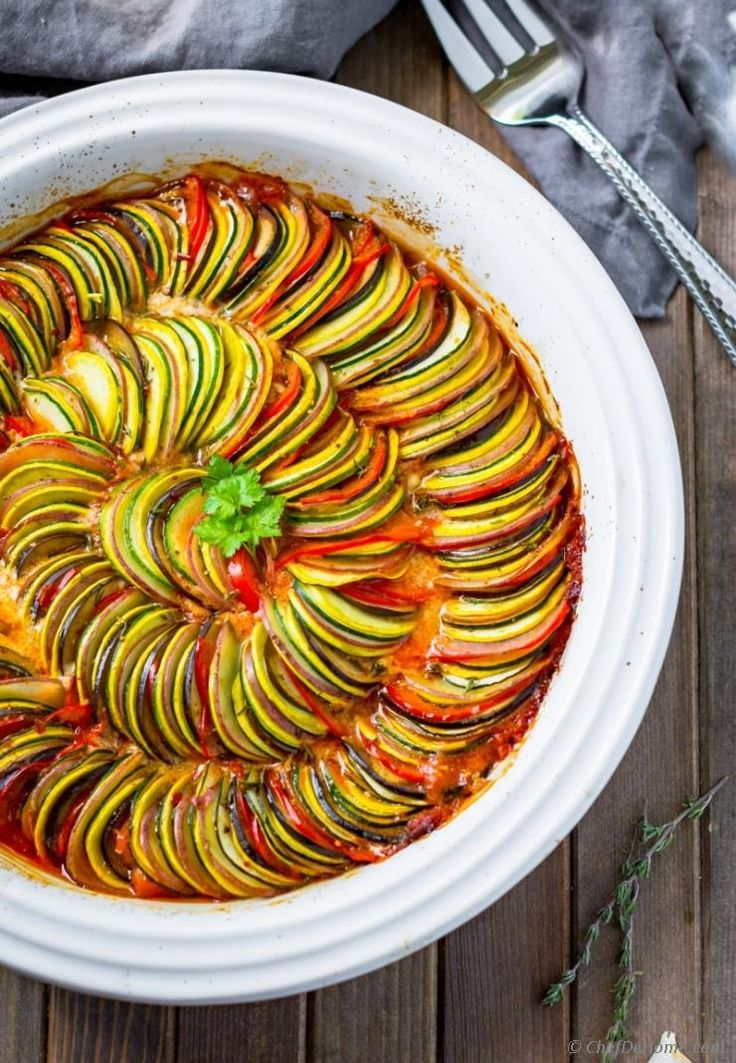 Bringing Ratatouille to your dinner table for meatless Monday! With colorful layers of fresh veggies, and garlicky tomato sauce