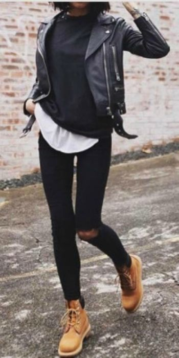 Petra + chunky black leather jacket + black tee + white one + striking contrast + distressed black jeans + Timberland boots + traditional biker chick style  Jacket: Acne Studios, Boots: Timberland.