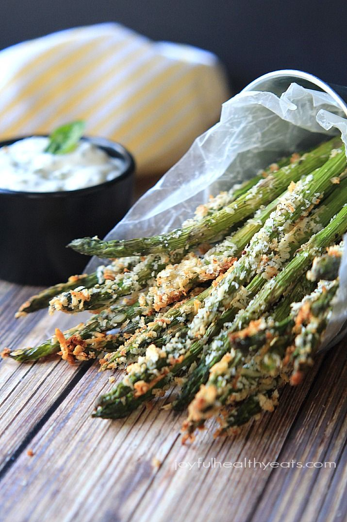 A healthy alternative to French Fries... Baked Asparagus Fries coated with panko bread crumbs and served with a Fresh Lemon Herb Aioli! The ultimate summer side dish! | joyfulhealthyeats.com