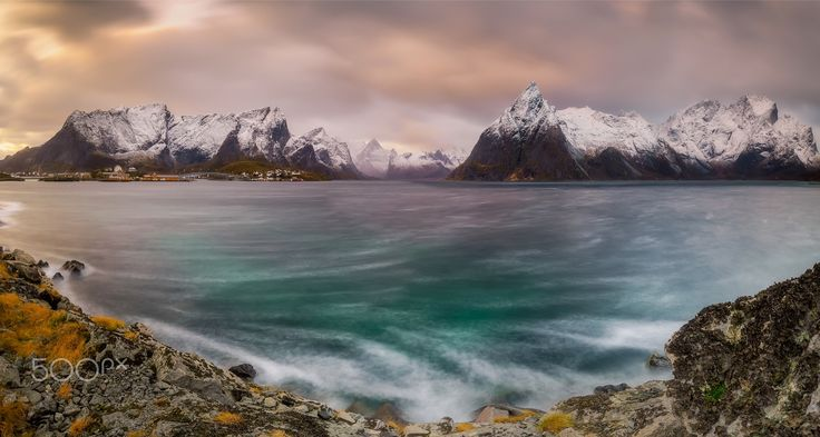 "Titan Moskenesøya  Lofoten - Taken November 26, 2016 in the vicinity of fantastic Reine ""Lofoten"", I was fascinated by the colours and reflections of the sea during sunset. Stopping my car in order to capture its majesty, I preferred to take an overview to get the most out of my sight, using a polarizing filter to amplify the seabed."